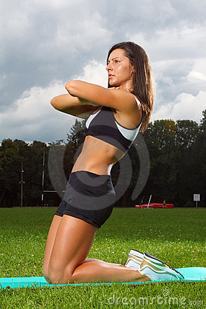 Young woman working out in a park