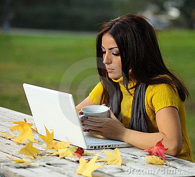 Young woman working outdoors