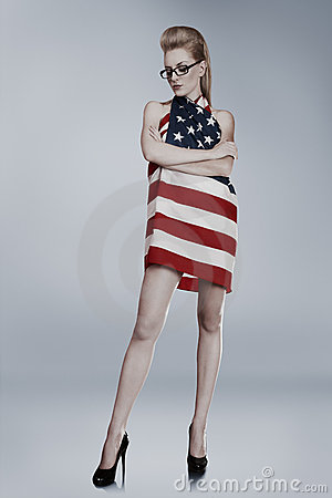 Young woman wrapped in american