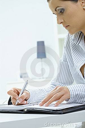 Young woman writing notes