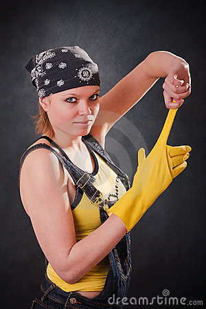 Young woman with yellow gloves