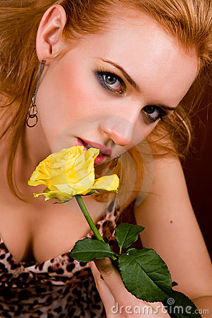 Young woman with yellow rose