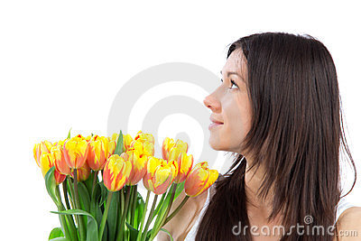 Young woman with yellow tulips bouquet of flowers