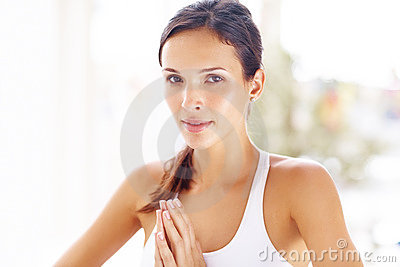 Young woman during yoga meditation looking at you