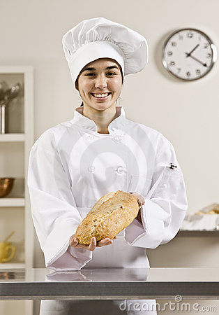 Young Women in chef s whites holding bread