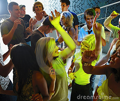 Young women dancing in lime colour spot light
