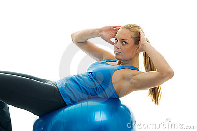 Young women doing crunches on fitness ball