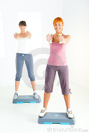 Young women doing fitness exercise
