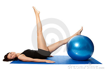 Young women doing pilates on fitness ball
