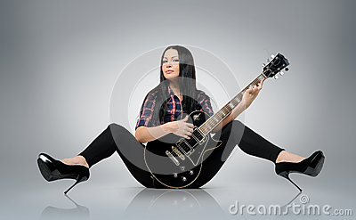 Young women with a electric guitar