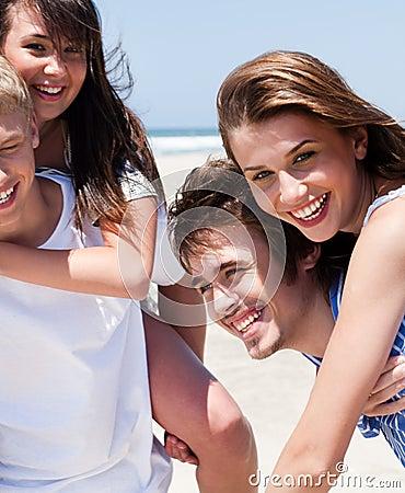 Young women enjoying piggyback ride