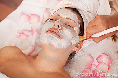Young Women Getting Facial Mask Royalty Free Stock Image - Image: 17400516
