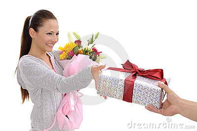 Young women with gift and flowers