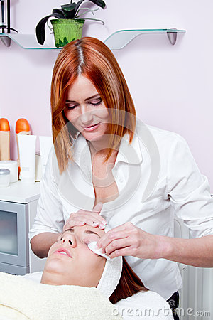 Woman having facial beauty treatment