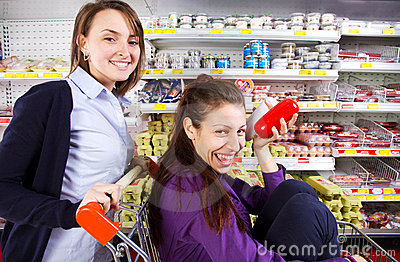 Young women having fun shopping