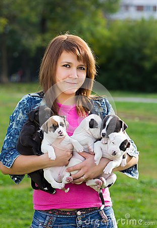 Young Women Holding Five Puppies