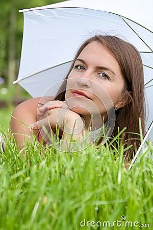 Young women lies on grass