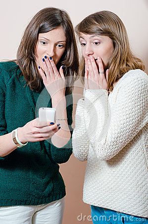 Young women looking at mobile cell phone