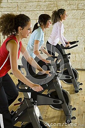 Free Young Women On Exercise Bikes Stock Photo - 4240790