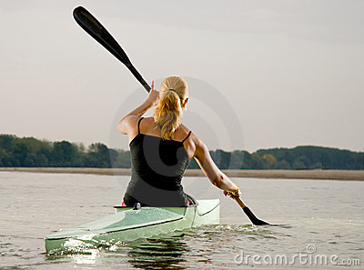 Young women paddling in kayak