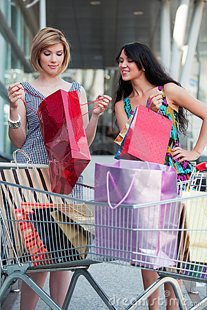 Young women with shopping carts