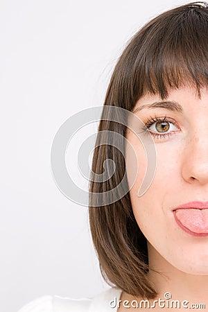 Young women showing her tongue