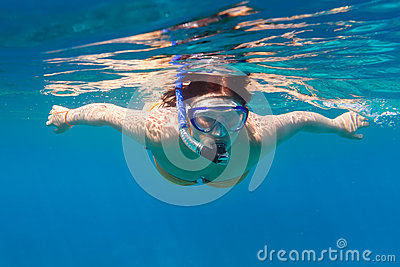 Young women snorkeling in the blue sea