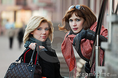 Two young fashion women on a city street