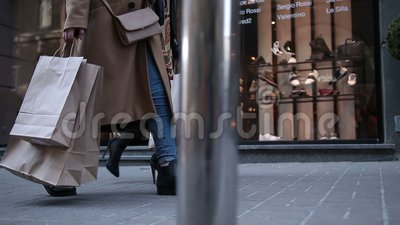 Young women walking with bags after shopping stock footage