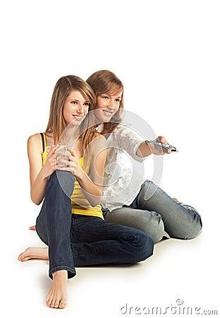 Young women watch TV
