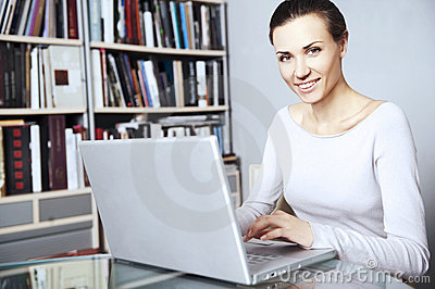 Young women works on a laptop