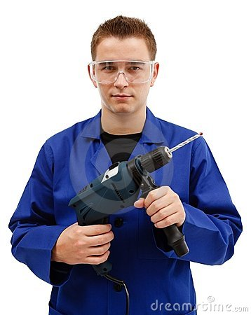 Young worker holding drilling machine