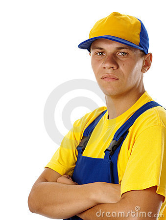 Young worker wearing baseball hat and uniform