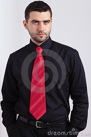 Young worried man in black shirt and red necktie