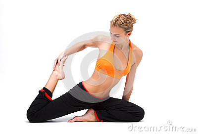 Younge woman stretching the muscles of her legs
