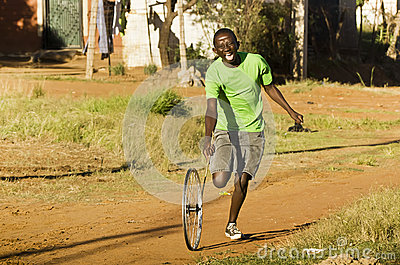 Youngster Playing with Wheel Rim