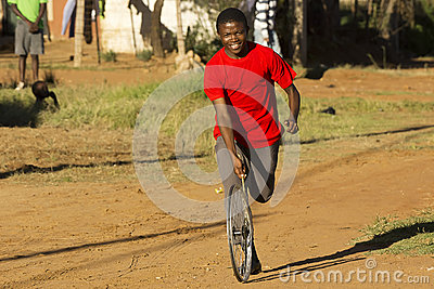 Youngster In Red T-Shirt, Playing with Wheel