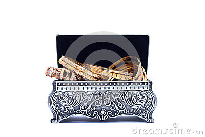 luxury gold bracelet in the opened silver antique chest
