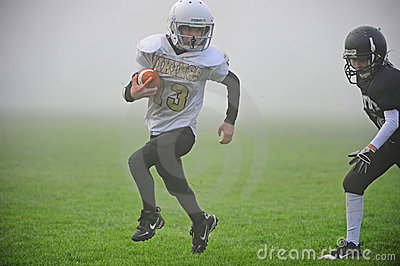 Youth American Football into the fog Editorial Image