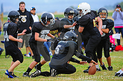 Youth American Football fumble Editorial Stock Photo