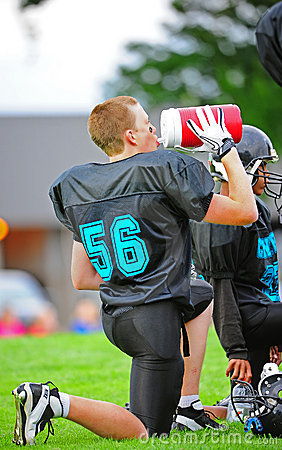 Youth American Football hydrating Editorial Stock Photo