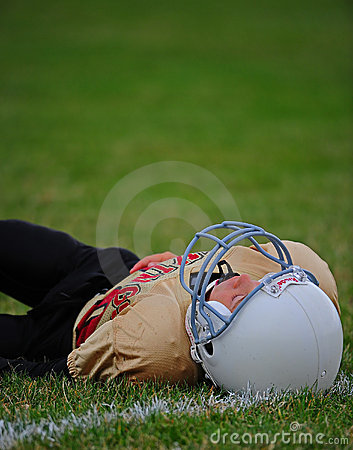 Youth American Football player down Editorial Stock Photo