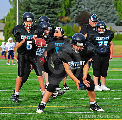 Free Youth American Football Quarterback Receives Ball Stock Images - 21257444