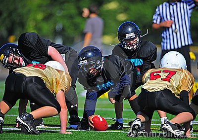 Youth American Football Scrimmage Line Ready Editorial Stock Image
