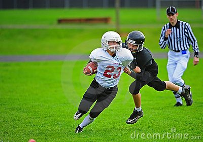 Youth American Football tackle Editorial Stock Image