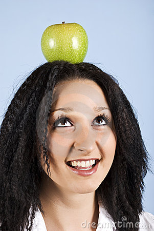 Youth with apple on her head