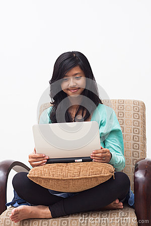 Beautiful young teenager girl holding laptop