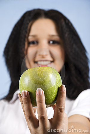 Youth female hold an green apple