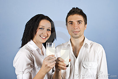 Youth happy couple holding milk glasses