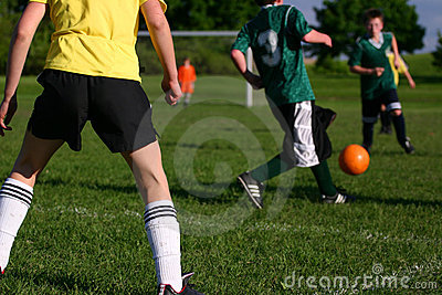 Youth kids soccer game on warm sunny day